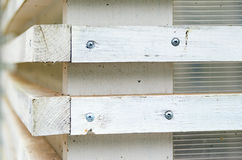 White wall with wooden blinds with horizontal bars Royalty Free Stock Photography