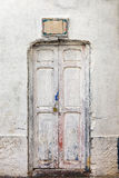 White wall and wooden grungy door. Stock Photos