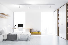 White walled bedroom with study corner, front Royalty Free Stock Image