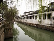 White walled houses along the canals in Suzhou old town. Suzhou, China - March 23, 2016: White walled houses along the canals in Suzhou old town Royalty Free Stock Photos