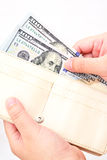 White wallet with US dollars in the hands Royalty Free Stock Photo