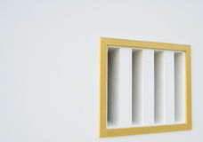 White walls have vents with golden edges. Royalty Free Stock Photo