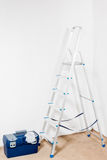 White walls, stepladder and a tool box Stock Photography