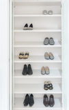White wardrobe with male and female shoes. On shelve Royalty Free Stock Photography