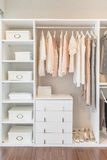 White wardrobe on wooden floor with dress Royalty Free Stock Image
