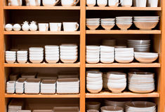 White Ware on Sale. Stacks of white ware on a wooden shelves for sale Stock Image