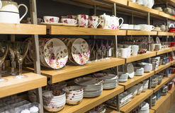 White Ware. Variety of decorated porcelain white ware in the wooden shelves Royalty Free Stock Photography