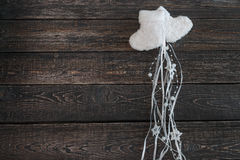 White warm baby booties on a dark background, new year, Christmas. ! Royalty Free Stock Images