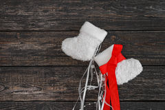 White warm baby booties on a dark background, new year, Christmas. ! Stock Photo