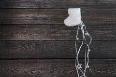 White warm baby booties on a dark background, new year, Christmas. ! Stock Photography