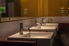 White wash bowl row in modern restroom interior,wash basin background. Toilet, men, wall, urinals, man, ceramic, male, clean, floor, hygiene, bathroom royalty free stock image