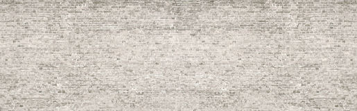 White wash old brick wall panorama. Vintage whitewashed brick wall panoramic background texture. Home and office modern design backdrop royalty free stock images