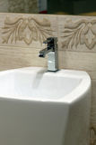 White washbasin and chrome tap Stock Photo