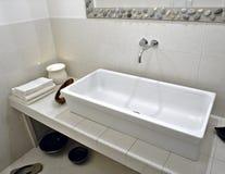 White washbasin in modern bathroom Stock Images