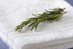 White Washcloths with a Sprig of Rosemary Royalty Free Stock Image