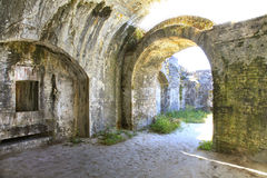 White Washed Brick Arches of American Fort Built in 1800s. The Old Worn Whitewashed  Brick Arches of an American Fort Built in the Early 1800s Stock Image