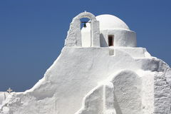 White washed church. White washed greek orthodox church on the island of mykonos against the blue sky Royalty Free Stock Images