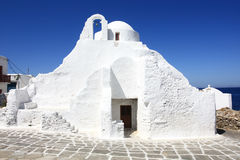 White washed church. White washed greek orthodox church on the island of mykonos against the blue sky Royalty Free Stock Photography