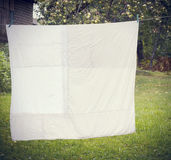 White washed duvet hanging. In the yard Royalty Free Stock Photography