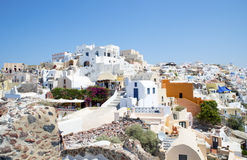 White washed houses at Oia. White washed houses, churches with blue domes and businesses in the village of Oia in the north of the Greek island of Santorini Royalty Free Stock Photo