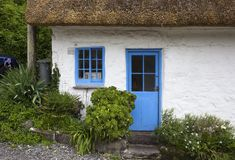 White-washed, stone cottage with thatched roof, Cadgwith, Cornwall, England Royalty Free Stock Image