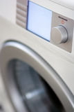 White washer. With power and program button, blue display is switched on Stock Photos