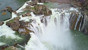 White water cascades over rocks of Shoshone Falls in Idaho. Snake river water fall roars over the rocks during spring runoff stock video