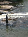 White water fishing!. Fishing in the river royalty free stock photos