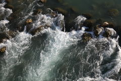 White water rapids. Flowing stream on the river Royalty Free Stock Images