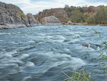 White water rapids in Mykolaiv Region, Ukraine. Fast flowing rapids of the Southern Buh (Yuzhny Bug) River and granite rocks in the Buzkyi Hard &#x28 Royalty Free Stock Image