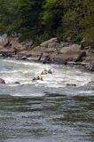 White Water Rating. Groups Battling Rapids Royalty Free Stock Image