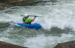 White Water Rifting. Kayaks and rafting a fun by dangerous sport. Paddle nature fun swift turbulence overturn Royalty Free Stock Photography