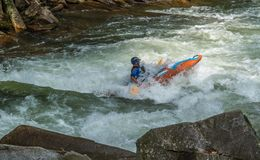 White Water Rifting. Kayaks and rafting a fun by dangerous sport. Paddle nature fun swift turbulence overturn Royalty Free Stock Photo