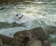White Water Rifting. Kayaks and rafting a fun by dangerous sport. Paddle nature fun swift turbulence overturn Stock Photos