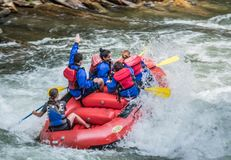 White Water Rifting. Kayaks and rafting a fun by dangerous sport. Paddle nature fun swift turbulence overturn Royalty Free Stock Images
