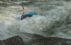 White Water Rifting. Kayaks and rafting a fun by dangerous sport. Paddle nature fun swift turbulence overturn Stock Photography