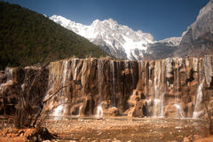 White water river waterfall under the mountain range. Royalty Free Stock Image