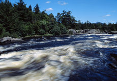 White water rush. The beautiful white water of a river in central,maine royalty free stock image
