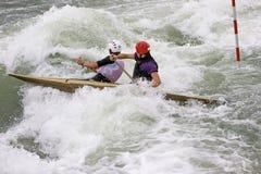 White Water Slalom. Two canoeists paddling through white water Stock Image