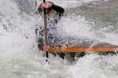 White Water Slalom. A canoeist paddling through fast running white water Stock Photo