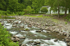 White water stream and white house Stock Images