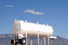 White Water Tanker. A white water tanker truck on a construction site in the desert Royalty Free Stock Images