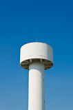 White water tower in the blue sky Stock Images