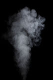 White water vapor. Abstract white water vapor on a black background. Texture. Design elements. Abstract art. Steam the humidifier. Macro shot Stock Photos