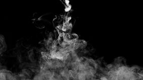 White water vapour on a black background.  Stock Photos