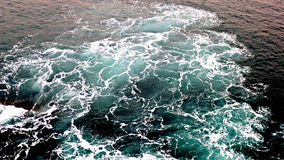 White water. The waves crashing on the cliff stock image