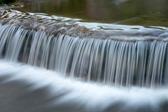 White waterfall from small river Royalty Free Stock Photo