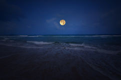 White wave and blue sea with full moon Stock Photo