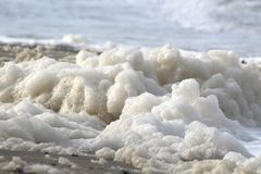 White wave foam on the beach at baltic sea royalty free stock photos