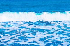 White waves. From blue sea background Royalty Free Stock Photography
